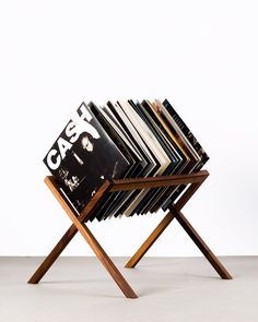 The Vinyl Stand is the perfect way to show off the best albums in your record collection. It holds up to 30 albums and is handmade in oak or walnut.