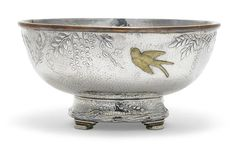 An American sterling silver and mixed-metal footed center bowl by Tiffany & Co., New York, NY,  circa 2000