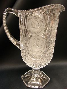 Large Glass Pitcher   Pressured glass with acid etched floral designs.