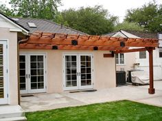 "Attached Garden Pergola (Options:10' L x 14' W, Mature Redwood, No Electrical Wiring Trim, Rafters at 18"" and Slats at 18"", Lengthwise Roof Support Timbers, 1-Anchor Kit for Stone, No Ceiling Fan Base, No Privacy Panels, No Curtain Rods, 9' Post Height, Transparent Premium Sealant). Photo Courtesy of Mr. Steve Chuck of San Marino, CA."