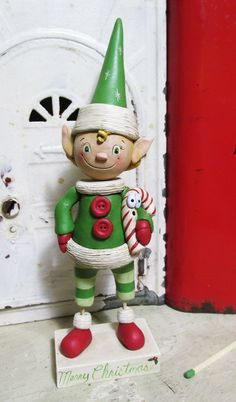 Christmas FOLK ART Elf with tall pointed hat original art by Janell Berryman Pumpkinseeds by JanellBerryman on Etsy Christmas Holidays, Christmas Crafts, Merry Christmas, Christmas Ornaments, Sculpture Clay, Sculptures, Paperclay, All Holidays, Paper Mache