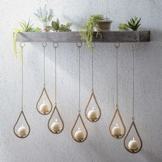 We're loving the 'Wooden Ledge Hanging Teardrop Candle Holder' right now! This striking piece is sure to add traditional flair to your wall decor!