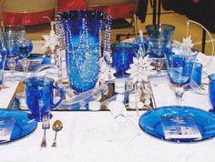 A blue, silver and white winter table...Note the dangling snowflake at each setting