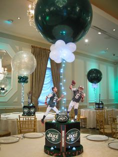 Jets Themed Centerpieces with Alternating Solid