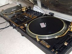 These are the gold version of the Technics that i use to DJ. I use the 1200 M5G which are the Grandmaster Flash edition of the turntables are named after the Legendary DJ of the Furious Five and works with artists suchs as Run DMC as well. I was amazed that i was able to get my hands on a copy of the signature turntables. My next purchase will be to gain these gold edition of these Turntables.