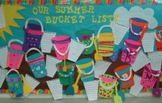 A colorful summer themed bulletin board has contruction paper sand pails alongsi