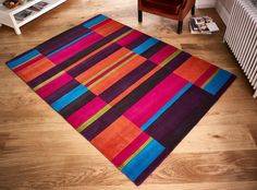 Vibrant Colour Theme, Exciting Blocks Design & Premium Wool Fibre_ This rug is all you need for your floor. #woolrugs #largerugs #modernrugs #luxuryrugs #multicolouredrugs