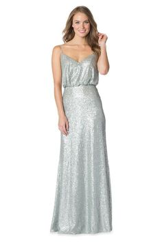 Especially when you go really shiny or sparkly, having a flattering silhouette is critical to making your bridesmaids feel fabulous.  This sequined silver blouson bridesmaid dress looks great on several body types.