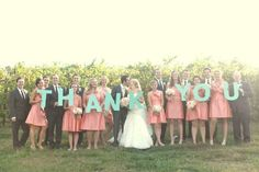 "Wedding Thank You Photo: Have your wedding party pose with letters spelling out ""Thank you."" This photo can be incorporated into the thank you notes that you send out to all the guests that attended your special day."