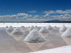 Salar de Uyuni, Bolivia.  This is the Earth's biggest salt flat at 10,582 square kilometers. Because this place is so eerily reflective, it can make the sky above seem to truly go on and on! Try this place on for size when you really want to feel your smallness.
