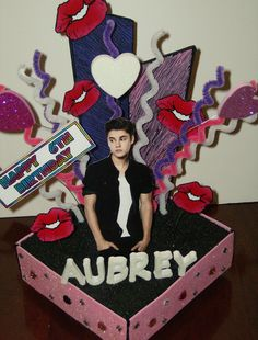 This is a personalized Justin Bieber themed CAKE TOPPER/CENTERPIECE.    Everything is hand made, hand painted along with crafting supplies used. This topper will include the name of the birthday child & a Happy (age) Birthday sign.    This is a wonderful piece to make your cake stand out and it matches with the  Justin Bieber birthday party theme.  many other party items & invitations to match available…
