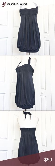 """BCBGMaxAzria Halter Mini Dress Elegant dress by BCBGMaxAzria.  Navy blue in color with a Halter style and sweet heart neckline.  Bubble style hem.  Would be perfect for a cocktail party or a summer wedding.  Excellent condition.  Material tag has been listed. Measurements laid flat: Bust:  16"""" Waist:  16"""" Hip:  20"""" Length from top of of bust to hem:  25"""" *Measurements are approximate. *Feel free to make an offer an I'll give you my lowest. BCBGMaxAzria Dresses Mini"""