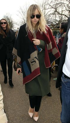 Suki Waterhouse shows us how to rock the Burberry poncho as an extra layer.