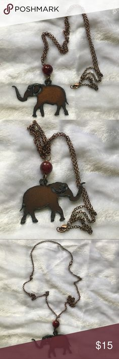 Handmade Metal Elephant Necklace Hand-carved One of a kind, unique piece of jewelry hand carved by an artisan in Mississippi. Features a metal elephant, maroon bead, and long chain with lobster claw closure. Check out my other items as I offer a 20% discount on bundles! Jewelry Necklaces
