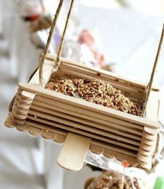 Relive those summer-camp memories of crafting with popsicle sticks. This birdseed bin features a tongue-depressor perch and is, of course, easy enough for kids to make, too. Get the tutorial.