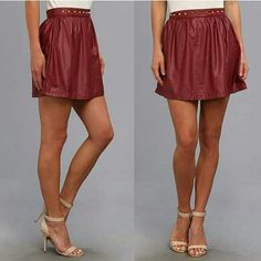 """SALE HP for City Chic party Faux leather mini skirt in rhododendron/ burgundy / red with a subtle sheen. Gold-tone metal studs set off the fixed waist. Concealed zip closure at left side. Straight hemline. Skirt in size L has bunched fabric at the waist, see pic #4.  Details: 100% polyurethane - Size M: waist 28"""", length 15"""" Size L: waist 30"""", length 16"""". Ali & Kris Skirts Mini"""