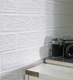 Paintable white brick wallpaper