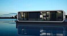 Floating micro-house / prefab / contemporary / energy-efficient WATERCOODO Coodo