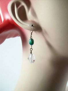 Simple and elegant pearl and quartz crystal earrings. Finished with silver…