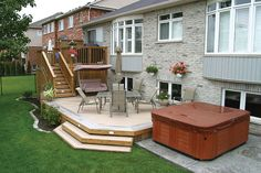 This 2 level deck is built in Burlington Ontario with a spa beside the lower level.