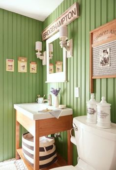 Faded Beadboard Paneling: Benjamin Moore's Bunker Hill paint covers this bathroom.