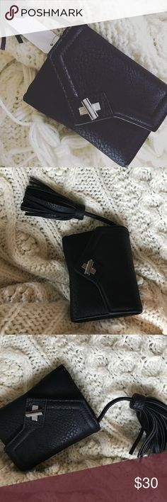 Black Tassel Clutch This looks like a clutch, but has the feel of a wallet! There are so many compartments and a seal for an ID. This is vegan leather. Bags Clutches & Wristlets