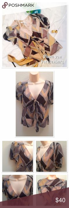 Diane von Furstenberg Blouse Beautiful 100% Silk . Blouse. The sleeves are sheer. Length 20in. Bust 28. Size says 8 but I think it's more like a small. Unless you would like to show some skin 😉 No damage . Love it❤ But not the price...... make an offer 😊 Diane von Furstenberg Tops Blouses