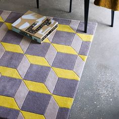 The Geometric Rug in Yellow and Grey combines in vogue retro designs with luxurious 100% wool yarns.