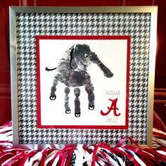 University of Alabama Crimson Tide Big Al Hand Print.  Paint your child's hand gray and print it on paper.  Then, paint in details like eyes, tail and feet, paint an A, and frame with a scrapbook paper matting!  Roll Tide! Crimson Tide Football, Alabama Crimson Tide, Alabama Football, Auburn Alabama, Sweet Home Alabama, Alabama Baby, Alabama Decor, Alabama Crafts, Alabama Room
