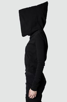 Women's black hooded asymmetric front zip sweater fromthe SS17collection from Rick Owens DRKSHDW.    Cropped body with bomber jacket fit and narrow elongated sleeves.  Made from a mediumweight cottonjersey.  Asymmetrical front Raccagni® zipper.  Oversized, peaked hood.  Made in Italy.    Material composition: 100% CO  Article code:DS17S5230