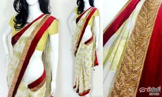 Off-white georgette saree CODE: SD100 PRICE: Rs.2960 SAREE: Off-white georgette brocade saree with self motifs all over having copper leaf design lace and a deep red velvet border with gold piping on the edge. Also has a stone dangler/latkan on the pallu BLOUSE: Gold shimmer material