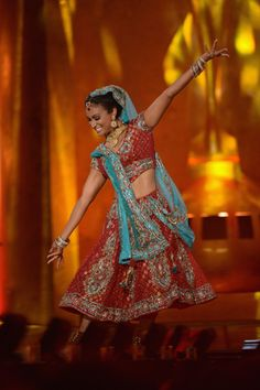 This is an Indian dance called Bollywood. It is a very upbeat dance that has folk and classical dance moves incorporated in it. Traditional clothing like the one shown in the image is worn when performing. In Islamic and Indian culture, dance is used for religious purposes and celebrations.
