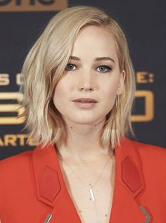 Jennifer Lawrence platinum lob does perfectly with a bright shade of red