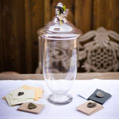 Instead of a guestbook, have guests write on small pieces of paper and put in a nice glass jar! Cute keepsake
