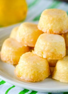 Recipe for Bite Sized Lemon Drop Cakes - these mini lemon cakes are drenched in a delicious lemon glaze, and they practically melt in your mouth! An unbeatable lemon treat. #lemondropcakes #minilemoncakes #minicakes #lemonglaze #minilemondropcakes #creationsbykara