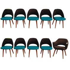 Set of Ten Saarinen for Knoll Executive/ Dining Chairs, Wood Legs   From a unique collection of antique and modern dining room chairs at https://www.1stdibs.com/furniture/seating/dining-room-chairs/