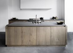Featuring solid oak timber cabinetry and pale concrete bench tops, the Signature kitchen is just one of six kitchen designs available as part of the new Piet Boon Kitchen line