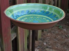 Find a pretty bowl or platter at the thrift store, glue a cast iron flange to the bottom and then screw to an iron pipe. Easy! A note from Rhyah: If your bowl is particularly deep, make sure to only put a small amount of water in the bottom so the birds can stand up in it. They won't bathe if they can't touch the bottom.