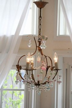 pretty chandelier for nursery lighting...enchanting in a vintage nursery or even a modern nursery for baby.