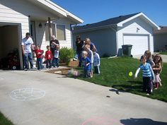 Defeat the Death Star game.   Sidewalk chalk to draw the Death Star, water balloons to wash it away~ Victory is OURS!
