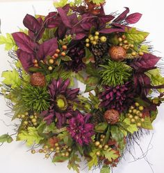Thanks so much for stopping by and visit my creations. All my wreath is unique and created in highest quality.  This lovely Autumn, Thanksgiving, Christmas, door wreath sets on a twig wreath base.  The wreath is embellished with olive green Dahlias, burgundy Sunflower /Mums. The wreath is accented with three brown Acorns, four Pine Cones and lots of Fall Berries. The wreath measures from tip to tip at 23 (L) x 23 (W) x 6.5(D).  The wreath needs to be placed in a protective area, away from…