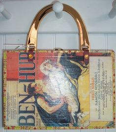 Original Cigar box purse made with the limited edition Gold Label Macanudo cigar box, embellished with the Ben Hur title in gold, red faux velvet lining, interior mirror.