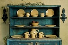 A cupboard of yellow-ware.