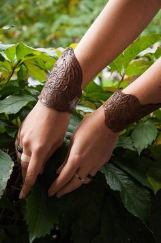 SINGLE decorative bracer //If you buy two items as a pair (left and right), the second one will be 35%off - just contact us//  Very beautiful and laborous leatherworked. Thick leather carved and deeply punched (and it can be painted with metallic paint - if you order it). You can use it as a every normal day cuff.  It can be in brown, green, or metallic version - you choose.  Designers: Magdalena Creators: Magdalena, Selser