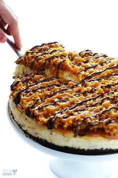"""Samoa Cheesecake This Samoa Cheesecake recipe is inspired by the famous Girl Scout cookies (a.k.a. """"Caramel DeLites"""")...."""
