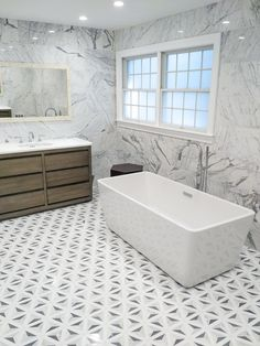 Artistic Tile I Combining the Duomo mosaic pattern in White with a marble in the same neutral color palette is a good compromise between timeless and modern style. Plus, whites and greys go with every color, so you can easily update the room with seasonal accent pieces. Interior Design by Anna Reduce of Dorato Homes