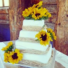 Rustic sunflowers and raffia wedding cake by Cake Appeal Utah