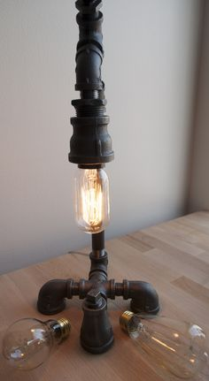 1000 images about industrial designed light fixtures on for Gas pipe lamp