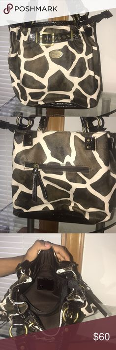 Dolce and Gabbana handbag Brown and white cow hide Dolce and Gabbana handbag.. medium size bag only carried a few times.. no stains.. smoke free home..100% Authentic!! Dolce & Gabbana Bags Shoulder Bags