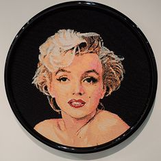 A portrait of Marilyn Monroe made with colored pushpins by David Mach - click through to the blog post to see a close up detail of the pin heads ... http://www.artsology.com/blog/2013/11/marilyn-monroe-by-david-mach/